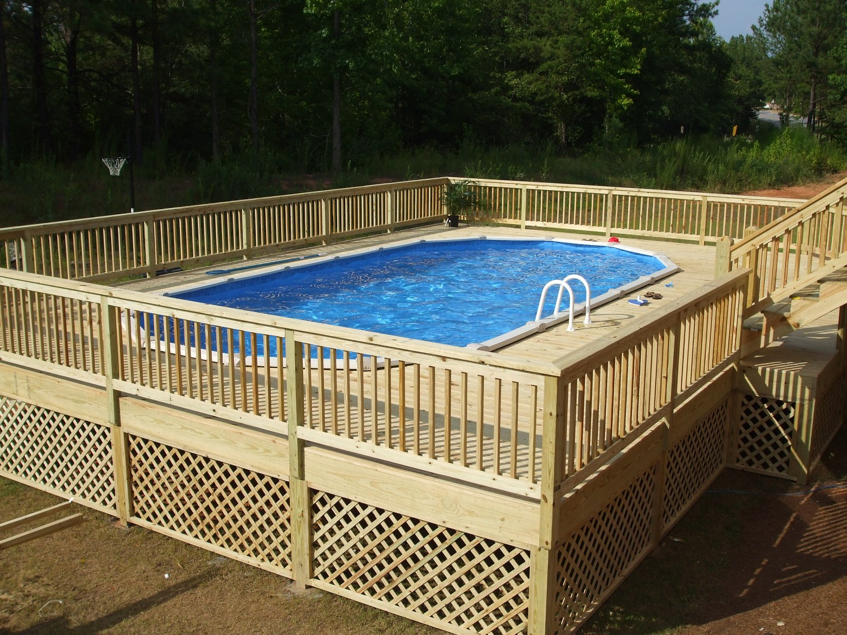 General contractor azteca outdoor atlanta ga deck pool for Above ground pool decks las vegas